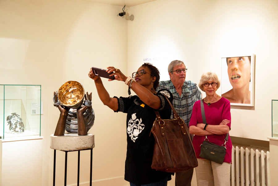 Visitors enjoy the artwork on display during 40 Under 40: The Next Generation of American Metal Artists. Photo courtesy of the Metal Museum.